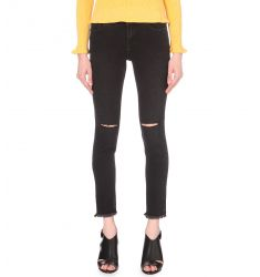 Distressed skinny mid-rise jeans